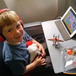 Braydon on a plane